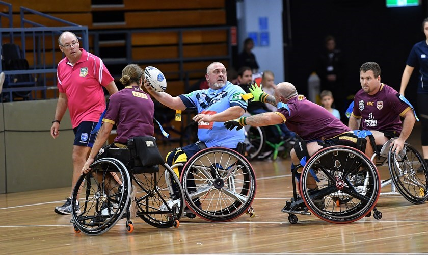 Action from the 2018  Wheelchair Rugby League match between NSW and Queensland.