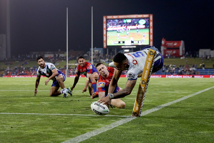 Peta Hiku looks on after putting Ken Maumalo away for a try in Newcastle.
