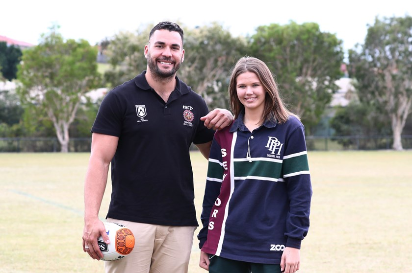 NRL Young Person of the Year, Holly Summers, with Titans captain Ryan James.