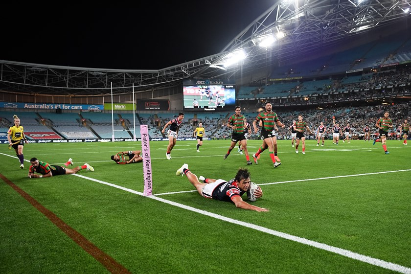 Roosters rookie Billy Smith scores.
