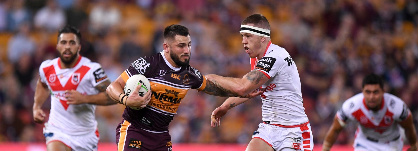 Brisbane centre Jack Bird fends off the Dragons in 2019.