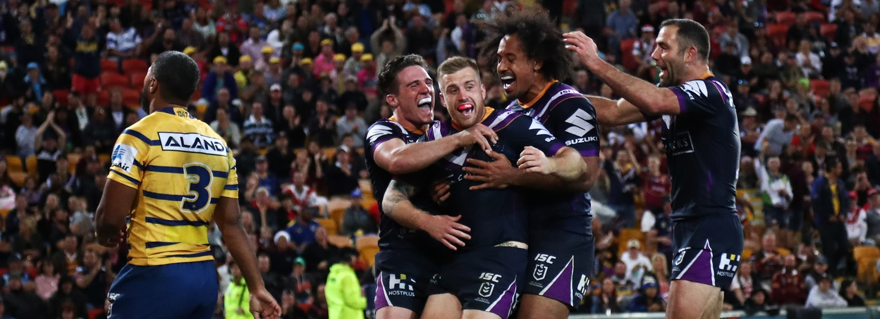 The Storm celebrate a Cameron Munster try.