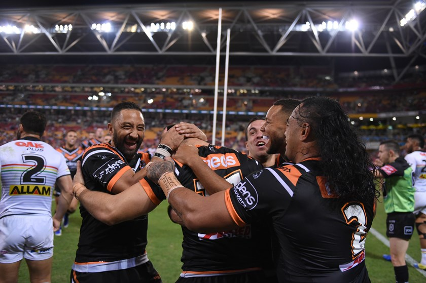 Wests Tigers celebrate a try.