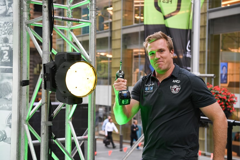 Jake Trbojevic lends a hand to set up the NRL Fan Fest site in Sydney.