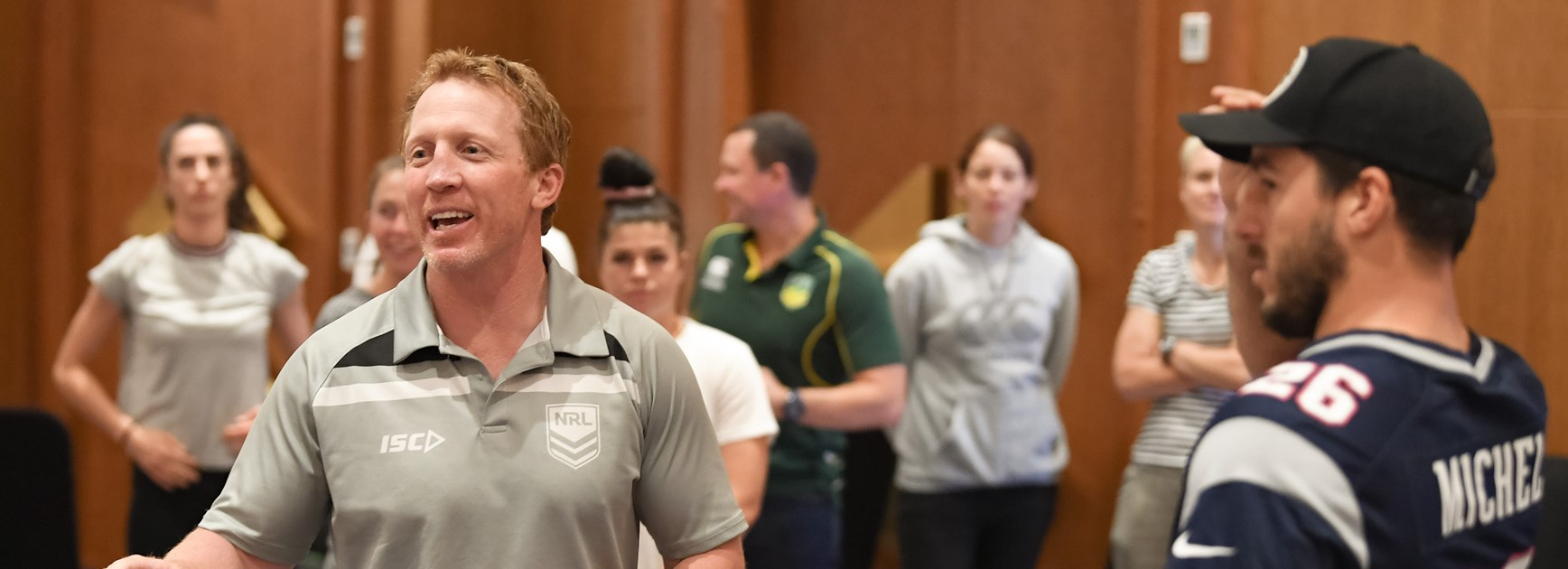 Alan Tongue leads Australian men's and women's PM's XIII players in a Voice Against Violence workshop.
