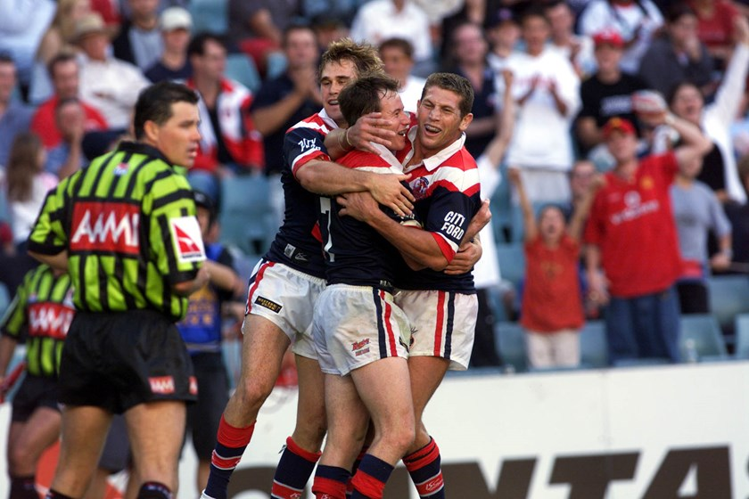 Justin Holbrook celebrates a Roosters try with Bryan Fletcher.