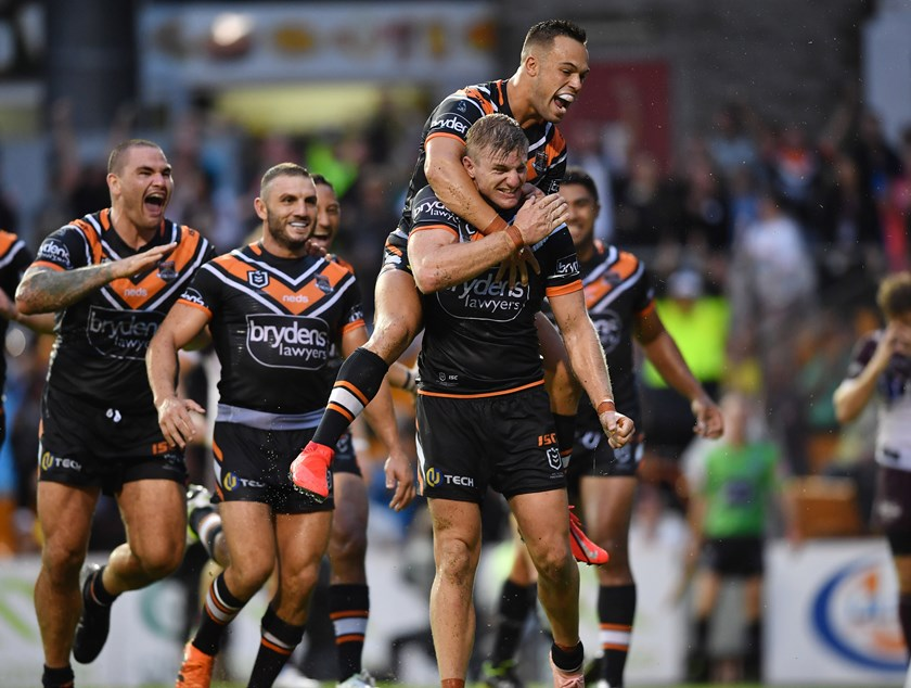 The Wests Tigers celebrate a try.