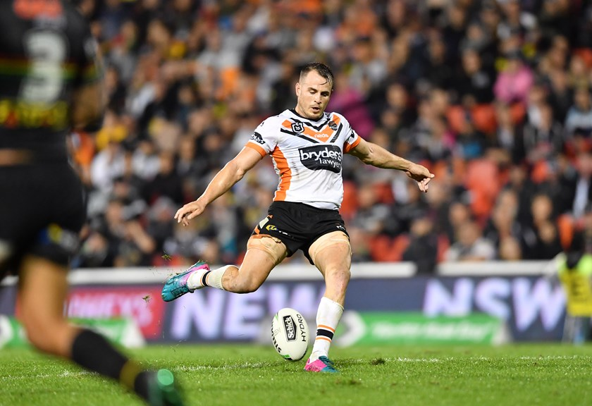 Tigers five-eighth Josh Reynolds takes aim for the field goal that hit the upright in the 9-8 loss to Penrith.