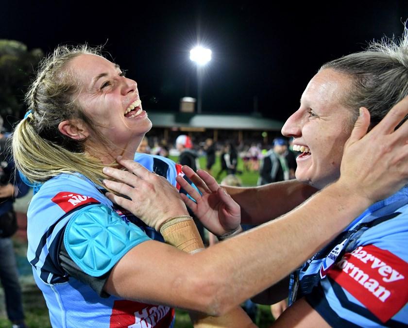 Kezie Apps and Holli Wheeler celebrate the Blues' Origin win.