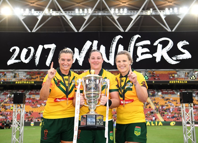 Steph Hancock celebrates the Jillaroos' 2017 World Cup triumph with Ruan Sims and Renae Kunst.