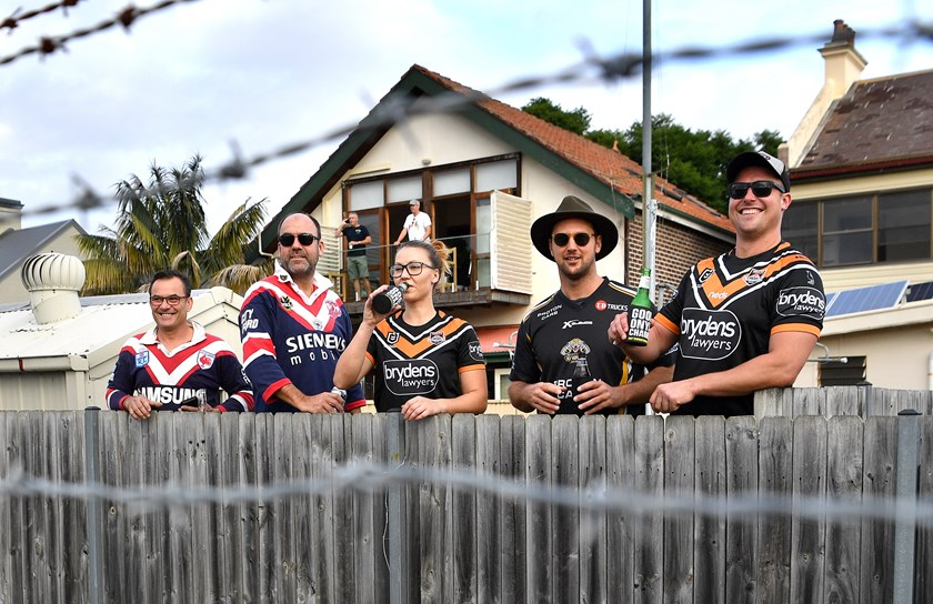 Roosters and Wests Tigers fans peer over the fence at Leichhardt Oval in round two.