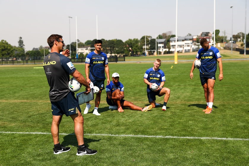 Andrew Johns passes on tips to Dylan Brown and Eels teammates at training.