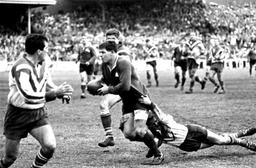 Bob McCarthy tries to break the Canterbury defence in the 1967 grand final.