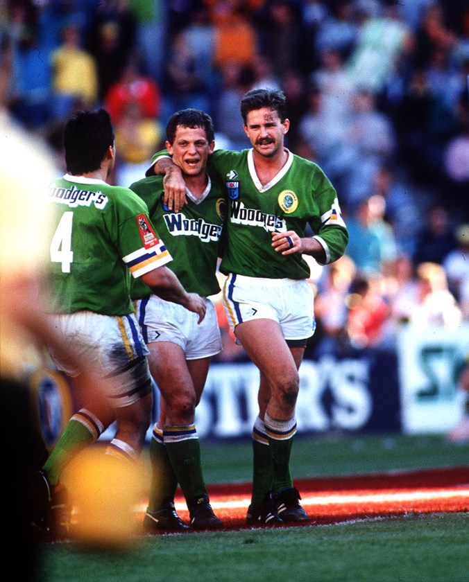 Laurie Daley, Steve Walters and Gary Belcher celebrate Canberra's 1989 grand final win.