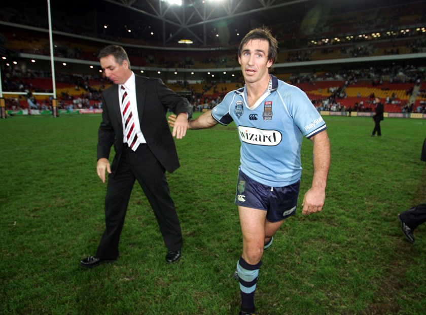Newcastle club comrades Michael Hagan and Andrew Johns were on opposite sides of the state divide in 2005.