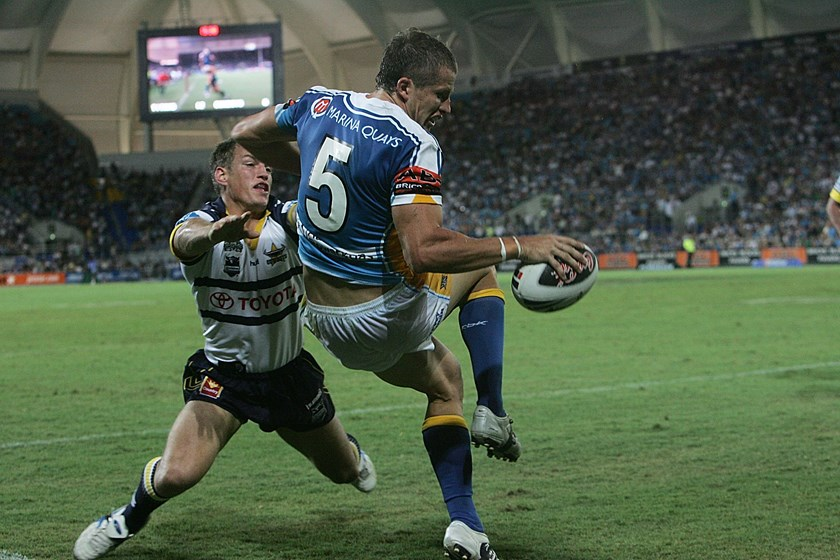Jordan Atkins touches down for the Titans against the Cowboys in round one of 2008.