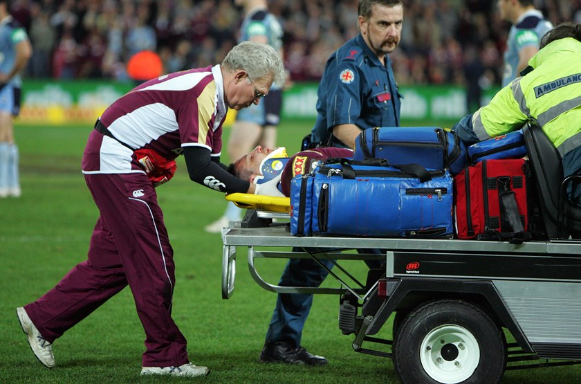 Steve Price is taken from the field after he was knocked out in game three.