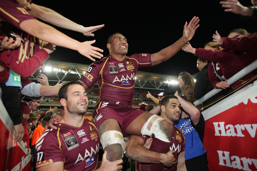 Petero Civoniceva is chaired from the field after his last Origin in 2012.