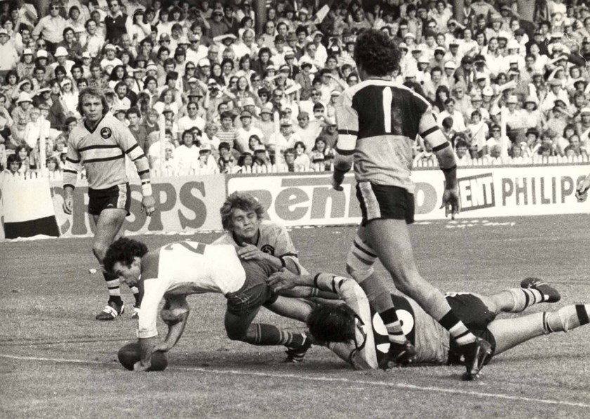 Chris Anderson scores a try against Cronulla.