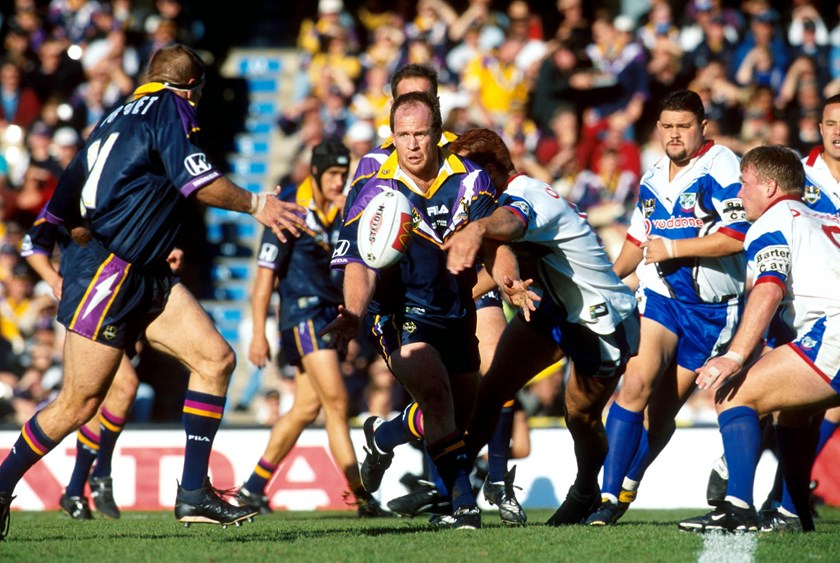 Russell Bawden gets an offload away for Melbourne in 2000.