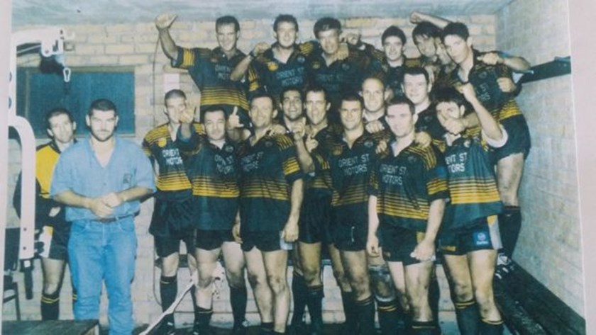 Brad Arthur, fifth from the right in the front row, with the Batemans Bay Tigers in the late 1990s. Future Knights coach Adam O'Brien is on the far right.