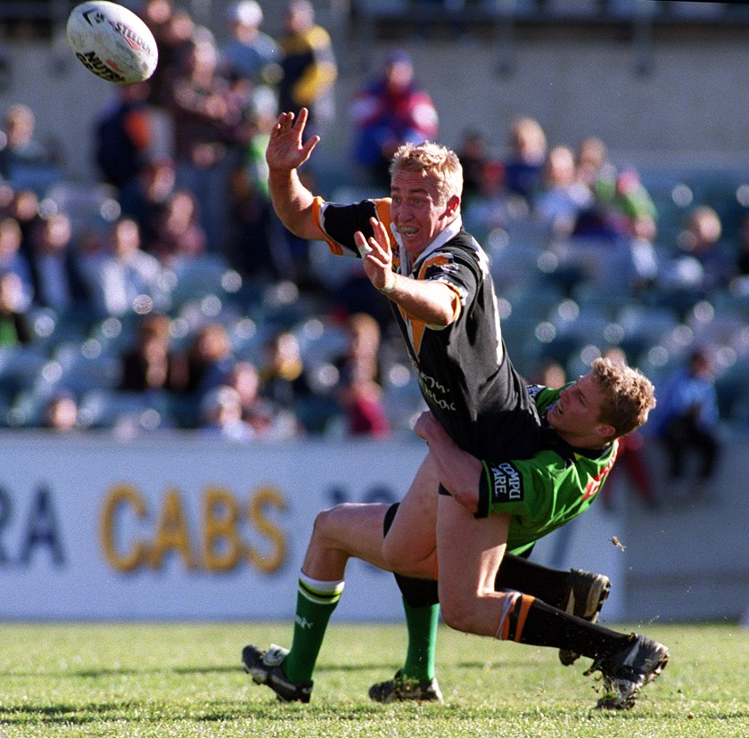 Trent Robinson offloads during his brief NRL career at the Wests Tigers in 2001.