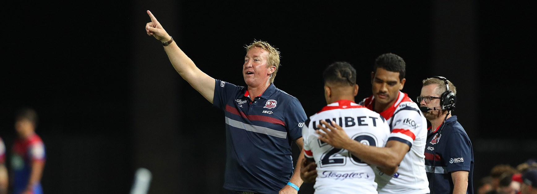 Trent Robinson makes some sideline instructions against Newcastle.