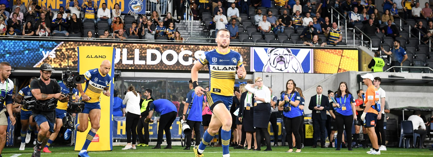 Clint Gutherson leads the Eels onto the field.