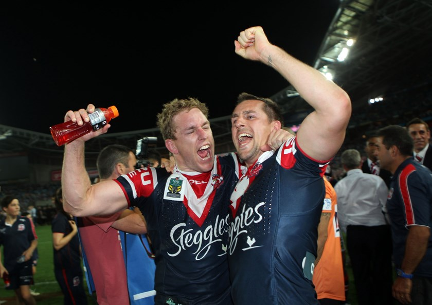 Mitchell Aubusson and Mitchell Pearce after the 2013 grand final.