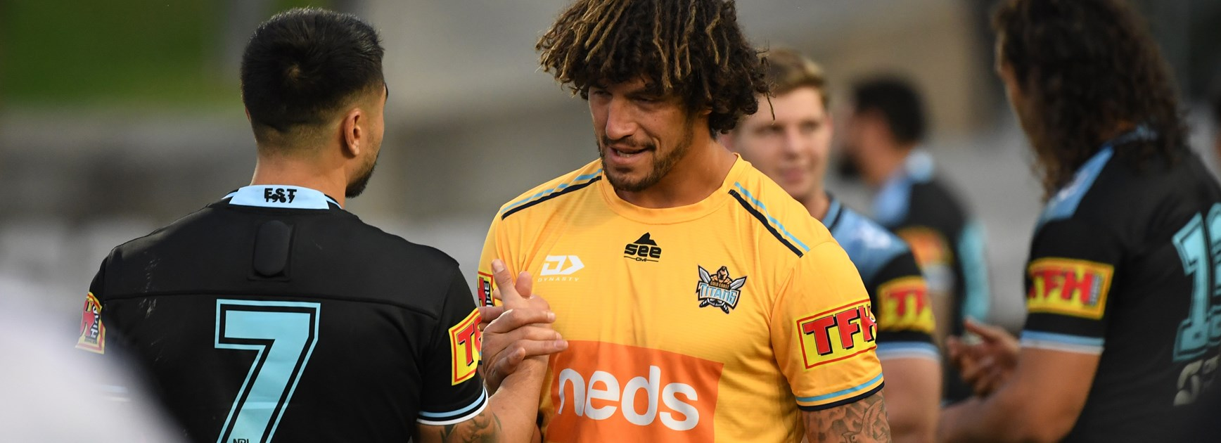 Shaun Johnson and Kevin Proctor shake hands after the game.