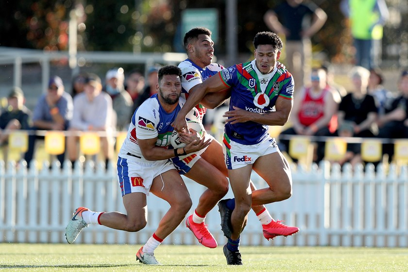 Newcastle's Gehamat Shibasaki is crunched by the Warriors.