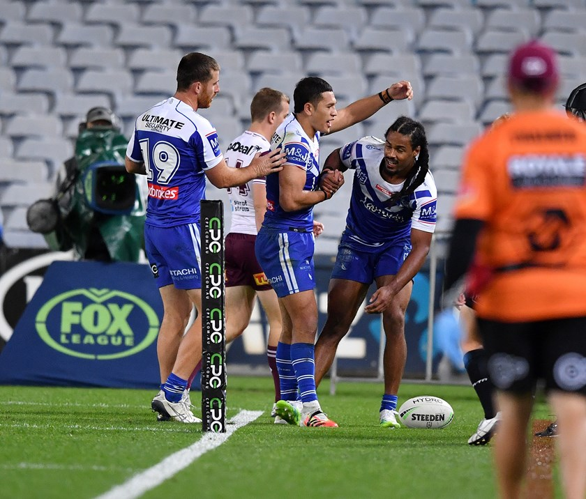 Jayden Okunbor is congratulated after scoring a try against Manly.
