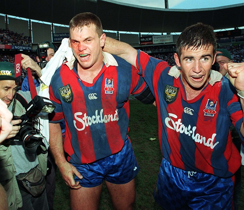 Paul Harragon and Andrew Johns celebrate the Knights' first premiership.