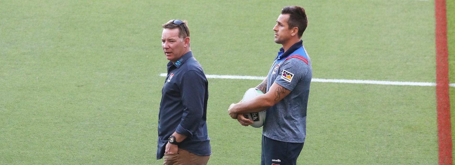 Knights coach Adam O'Brien and Mitchell Pearce.