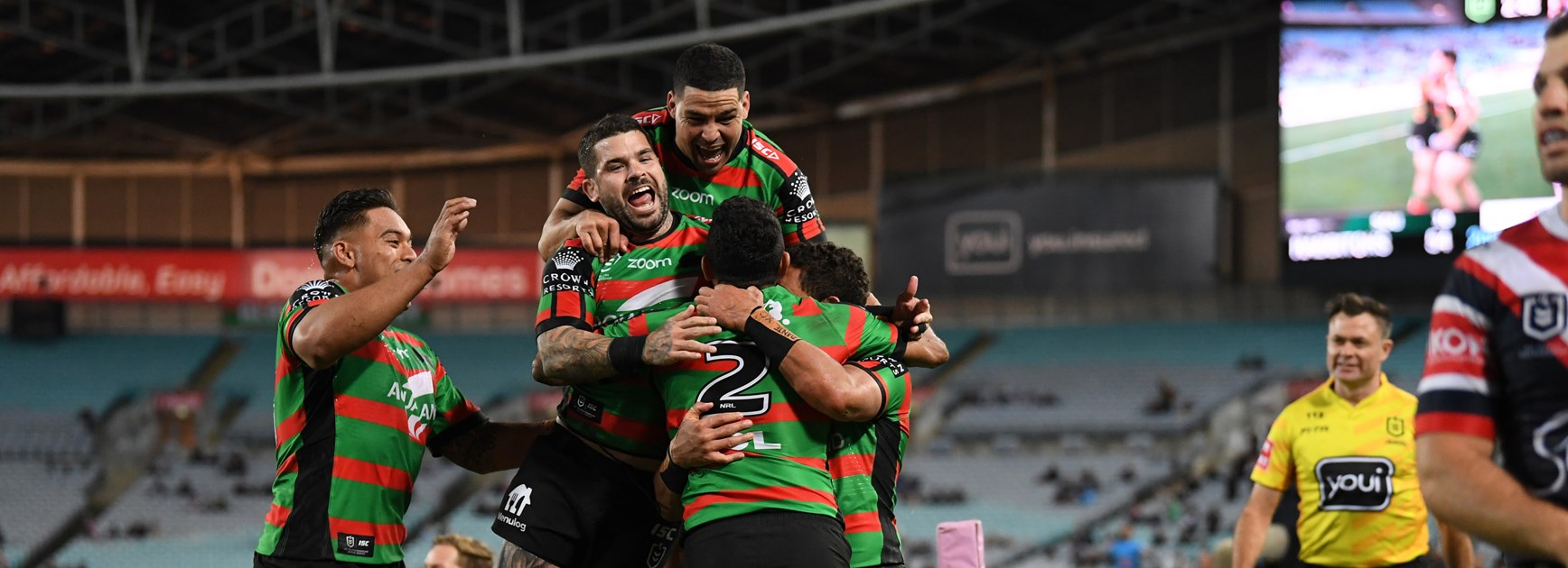 Alex Johnston is mobbed after his fifth try against the Roosters in round 20.
