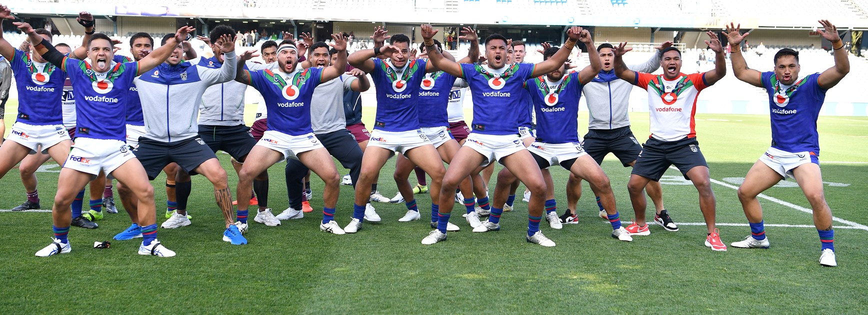 The Warriors players perform a haka.