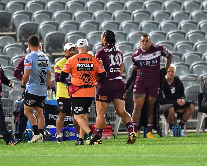 Manly prop Martin Taupau leaves the field injured in round 5.