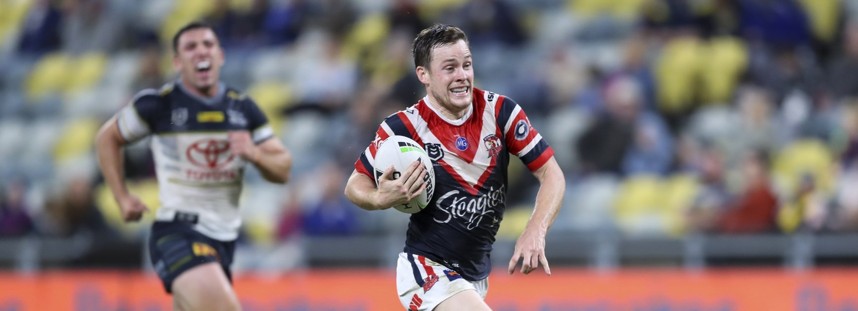 Luke Keary streaks away to score against North Queensland.