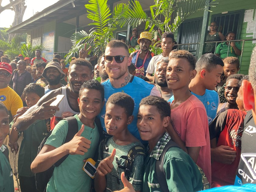 Sharks utility back Josh Dugan is swamped by fans in PNG.