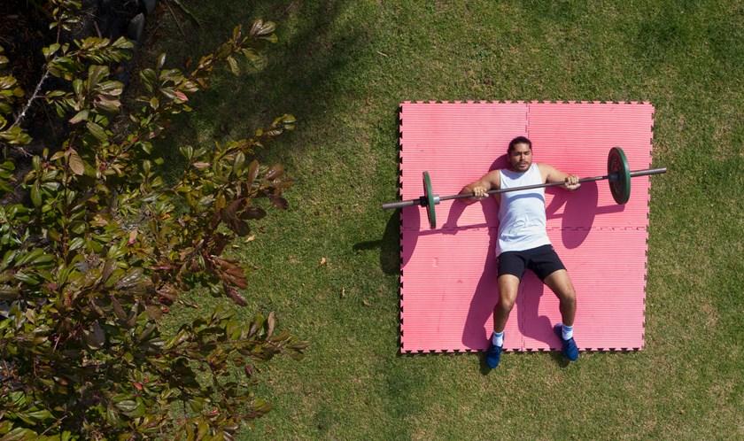 Tohu Harris working out in his backyard.