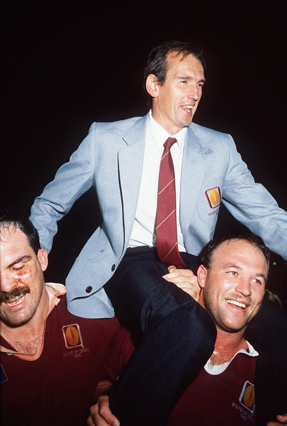 Wayne Bennett is chaired off by Martin Bella and Wally Lewis after the 1987 series win.