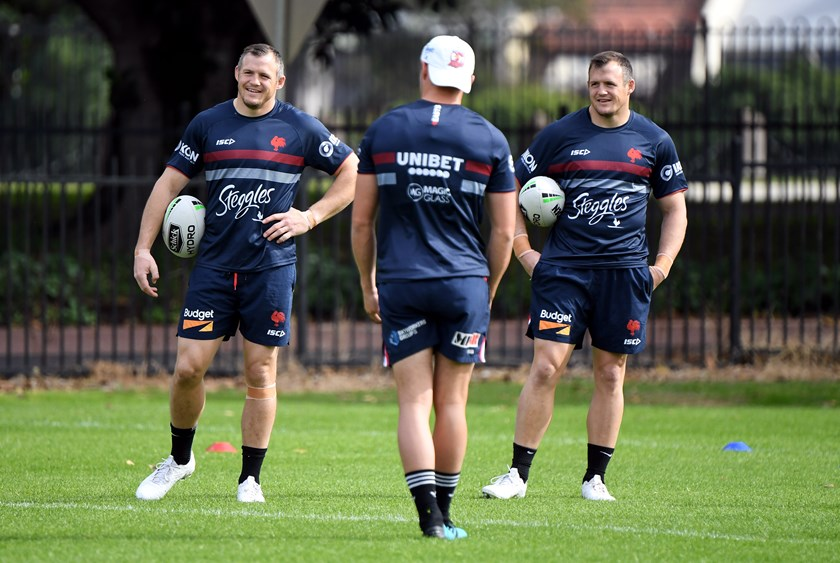 Brett and Josh Morris share a laugh at Roosters training.