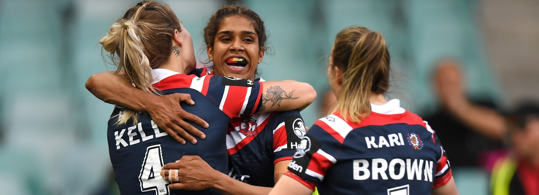 Taleena Simon celebrates a Roosters try.