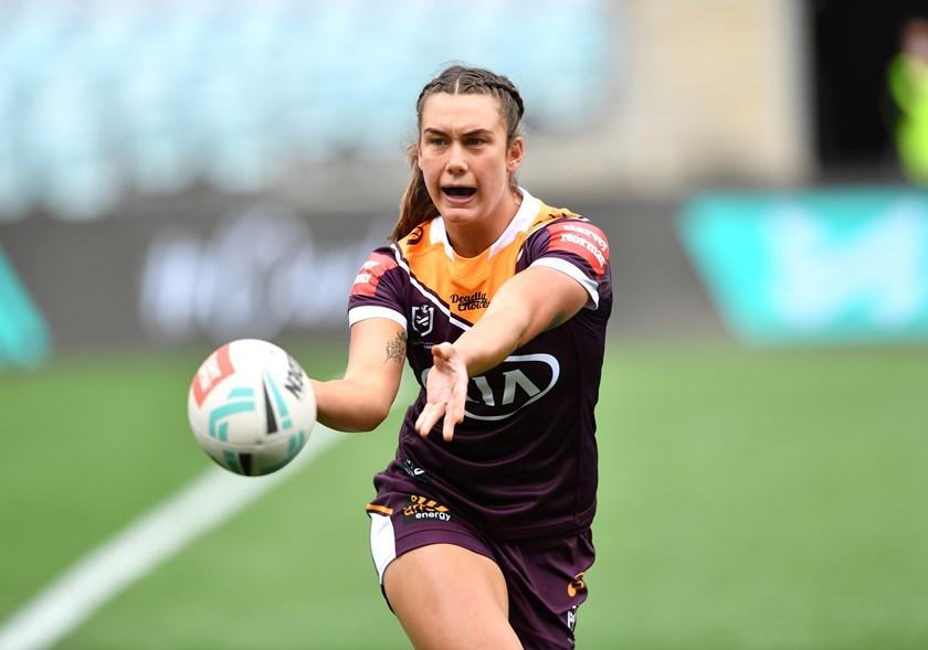 Jess Elliston sends a pass wide for Brisbane.