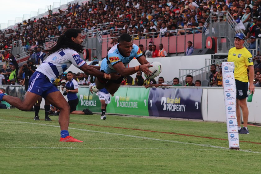 Sione Katoa scores a try for the Sharks.