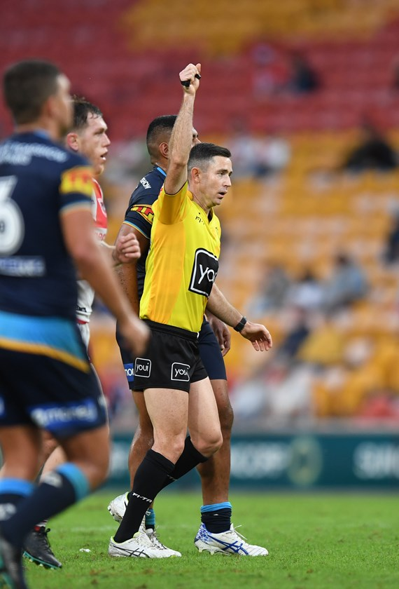 NRL referee Chris Sutton signals six-again.