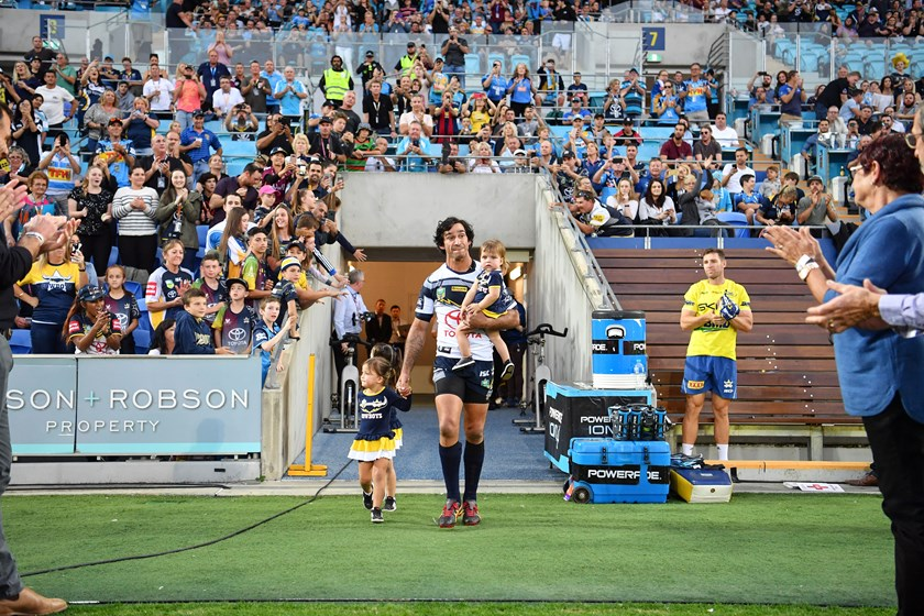 Johnathan Thurston runs out for his farewell game in 2018 with his three daughters.