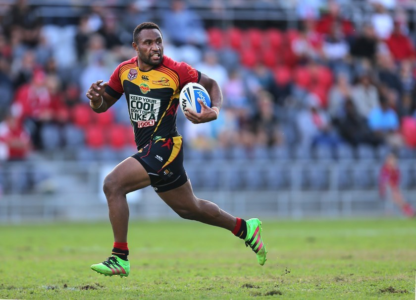 Justin Olam on the run for the PNG Hunters in 2016.