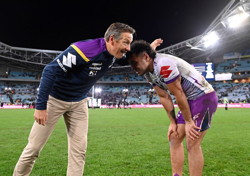 Craig Bellamy catches up with Jahrome Hughes after the siren.