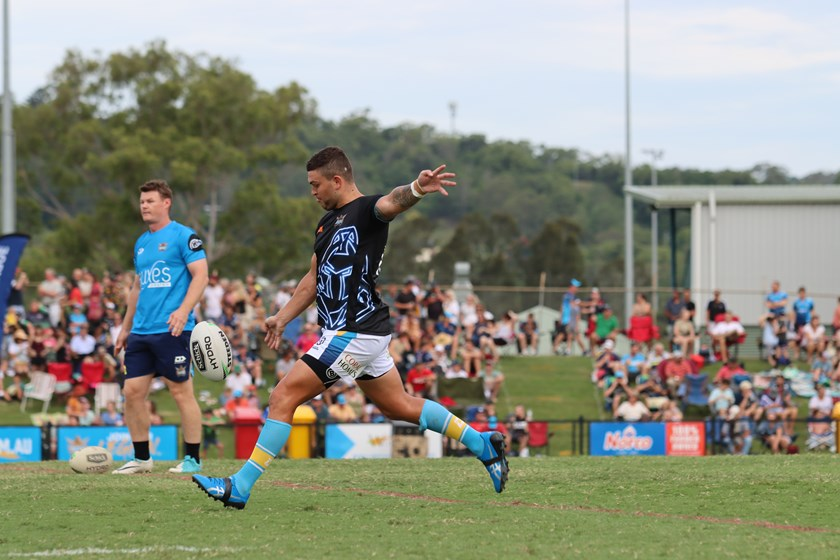 Ash Taylor warms up at Lismore before the trial against the Warriors.